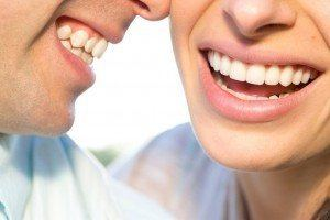 Couple beautiful teeth from dental bonding smiling together.