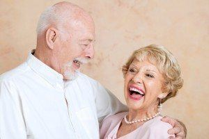 Senior couple in love, smiling because they got same day dentures in time for daughters wedding
