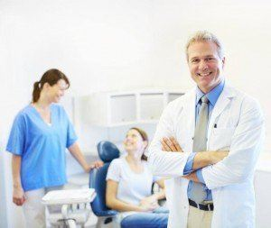 Dentist photo with assistant and patient providing general dentistry services