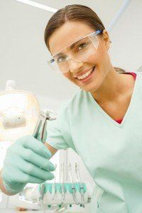 Dentist holding dental forceps and smiling used for a tooth extraction